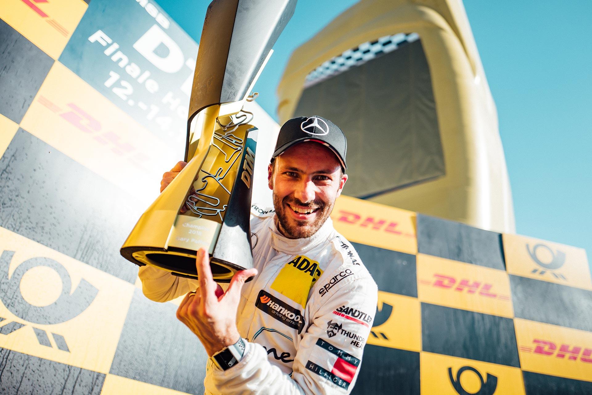 DTM-Finale auf dem Hockenheimring, 14. Oktober 2018. Gary Paffett auf Mercedes-AMG C 63 DTM (C 205) kommt auf Platz drei ins Ziel und sichert sich damit die DTM-Fahrermeisterschaft 2018. Die Teamwertung gewinnt Mercedes-AMG Motorsport PETRONAS (363 Punkte). Damit siegt die Stuttgarter Marke in allen drei Wertungen der DTM (Fahrer, Konstrukteur und Team). Es ist die letzte Saison von Mercedes-AMG in der DTM nach 30 Jahren erfolgreichen Engagements.